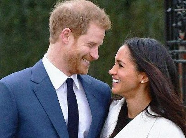 Prince Harry and Meghan Markle in the Sunken Garden at Kensington Palace, London, after the announcement of their engagement. (photo: PA/ Dominic Lipinski)