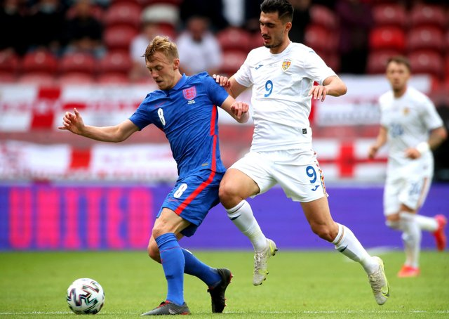 England's James Ward-Prowse (left) and Romania's Andrei Ivan battle for the ball during the international friendly match at Riverside Stadium, Middlesbrough. Picture date: Sunday June 6, 2021. PA Photo. See PA story SOCCER England. Photo credit should read: Nick Potts/PA Wire.Use subject to FA restrictions. Editorial use only. Commercial use only with prior written consent of the FA. No editing except cropping.