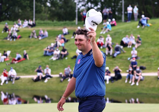 Marcus Armitage in front of the crowds celebrates his victory in the Porsche European Open (Picture: Getty Images)