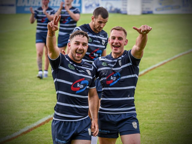 Tom Holmes, left, celebrates reaching Wembley after Featherstone Rovers' win over Widnes Vikings. (Dec Hayes Photography)