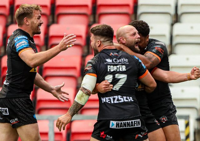 Semi-final joy: Castleford's Paul McShane is congratulated on his try by Jordan Turner, Alex Foster and Michael Shenton.