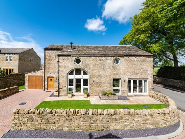 The converted barn for sale in Farnley Tyas