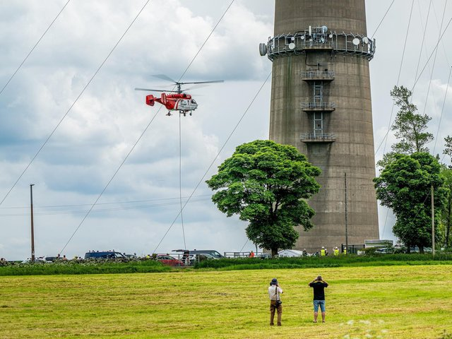 Bystanders took photos of the scene as the helicopter took off (Photo: Andy Jones CAG Photography)