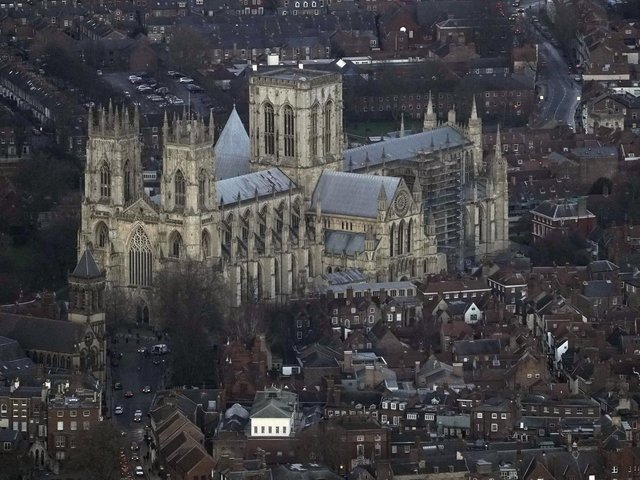 An aerial view of the centre of York, with the city's Minster dominating the skyline. A pioneering computer system has been introduced in the city to help tackle congestion and air pollution by managing traffic flows more effectively. (Picture: Owen Humphreys/PA Wire)