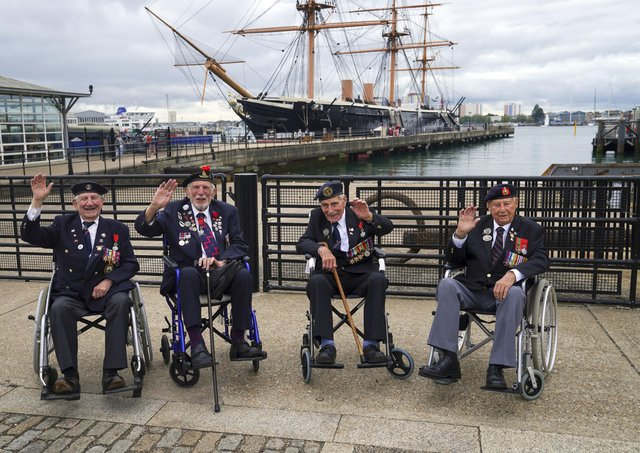 D-Day veterans from left: George Chandler, Joe Cattini, John Dennet and Jack Quinn are welcomed to the Portsmouth Historic Dockyard to commemorate the 77th anniversary of the Normandy Landings.