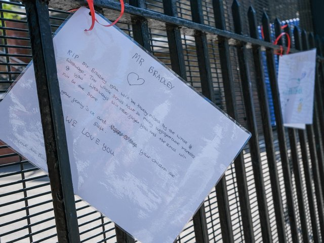 Tributes hung on the gates of the school