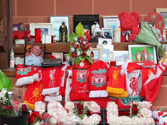 Flowers and tributes left at the Hillsborough Memorial outside Anfield stadium, Liverpool, following the collapse of the Hillsborough trial. Picture date: Wednesday May 26, 2021