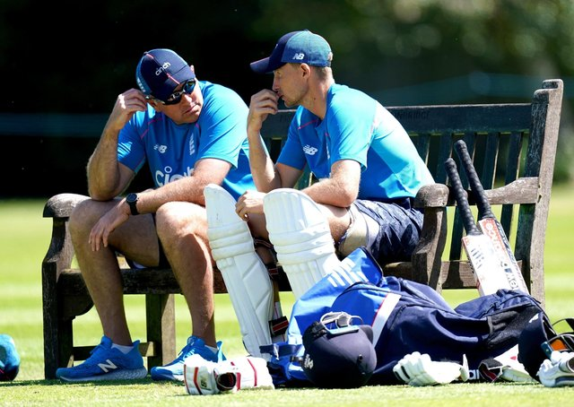 Careful whispers: England captain Joe Root, right, and coach Chris Silverwood, left, share some thoughts during a break in the nets session at Edgbaston yesterday. (Picture: PA)