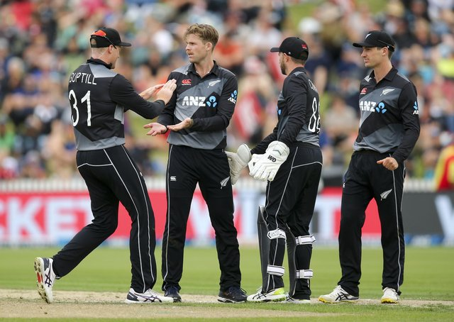 BOOST: Lockie Ferguson celebrates with Martin Guptill after taking the wicket of Bangladesh's Naim Sheikh in a T20 clash in Hamilton in March this year. Picture: Hagen Hopkins/Getty Images
