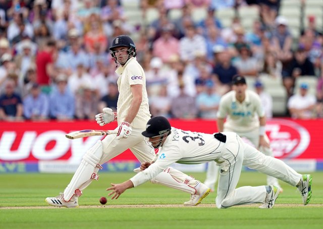 Got it: New Zealand's Will Young fields the ball off England's Dom Sibley during day one of the second Test at Edgbaston.
