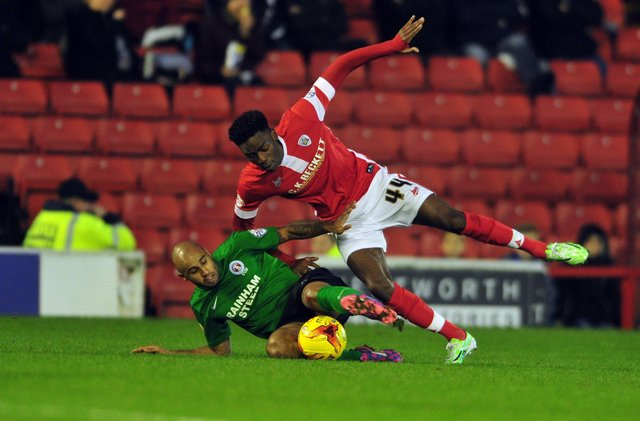 Remember me?: Barnsley's Devante Cole being challenged by Scunthorpe's Marcus Williams in 2014. Picture: Tony johnson