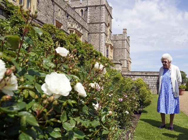 Queen Elizabeth II views a border in the gardens of Windsor Castle, in Berkshire