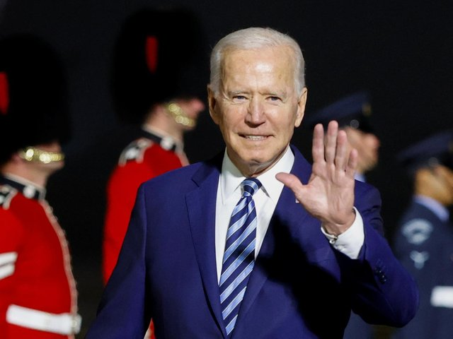 US President Joe Biden waves on arrival on Air Force One at Cornwall Airport Newquay ahead of the G7 summit.