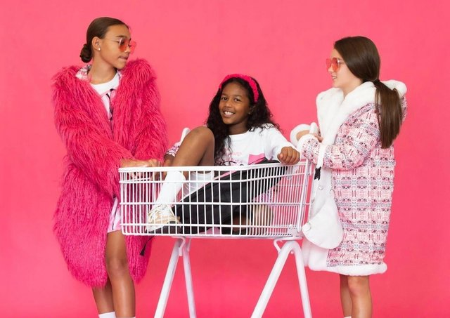Hot pink faux fur coat with artsy canvas print back, now £119.99; reversible white faux fur oversize hooded coat with print reverse, now £89.99, from House of Juniors at www.houseofjrs.co.uk