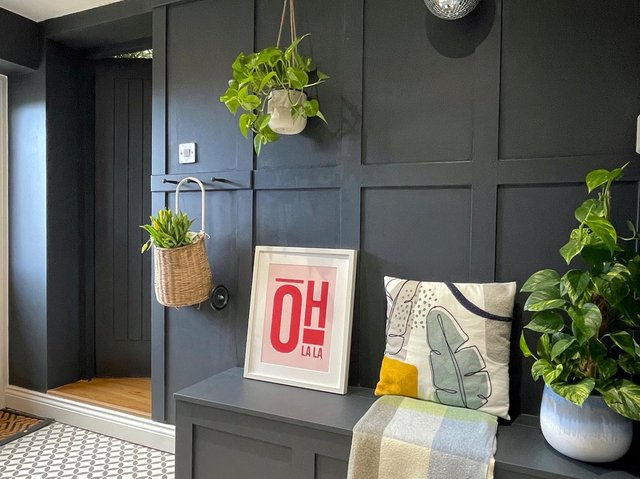 Panelling, plants and pictures make for a warm welcome in the entrance hall