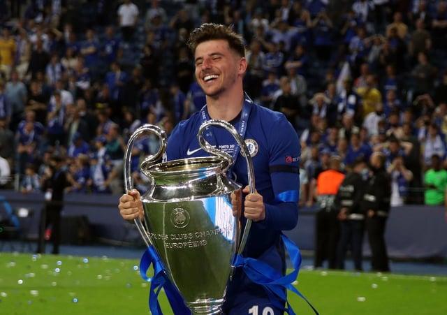 Chelsea's Mason Mount  lifts the Champions League trophy.