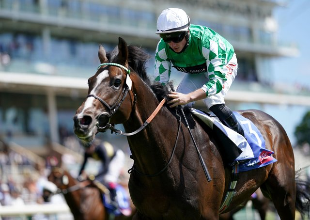 Roberto Escobarr and Tom Marquand coming home to win the Sky Bet Race To The Ebor Grand Cup Stakes at York Racecourse.