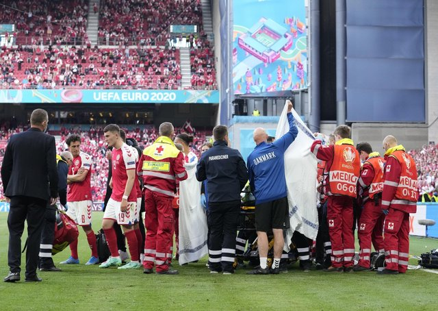 Denmark's Christian Eriksen: Receiving medical treatment after collapsing during the Euro 2020 Group B match between Denmark and Finland in Copenhagen.