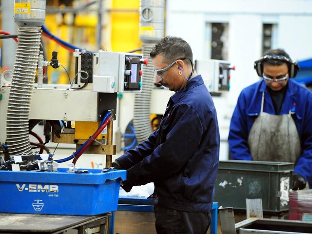 Library image of workers at a manufacturing company
