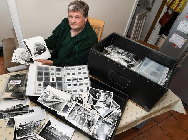 Some 3,000 photographs, dating as far back as the 19th century, will go on display at Finghall Lane Halt, run by the heritage Wensleydale Railway, after they were granted custody of the National Railway Museum's photography archive. Pictured: Guy Loveridge with the archive