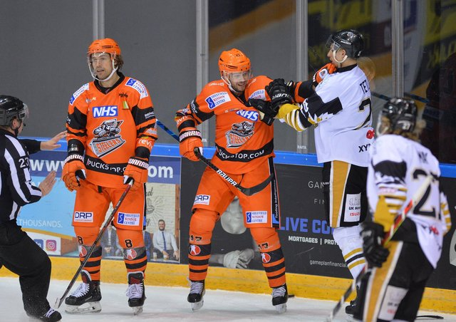 WE'LL MEET AGAIN:  Adrian Saxrud Danielsen, right, gets to grips with a Nottingham Panthers opponent during the Elite Series - something he'll be able to do more of next season in the Elite League. Picture: Dean Woolley.