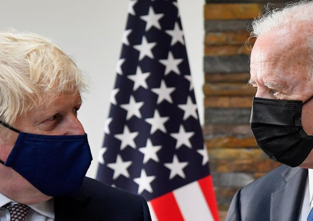 US President Joe Biden (right) talks with Prime Minister Boris Johnson during a meeting at the G7 summit in Cornwall.