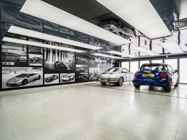 The owner has created a car gallery/showroom open plan to a sitting room so he can sit and enjoy his vehicles