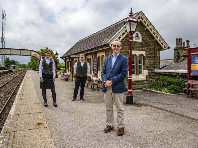 Adrian Quine, right, with Emilia Steven and Alan Collinson from Rail Charter Services Ltd at Settle railway station.Picture by Tony Johnson.