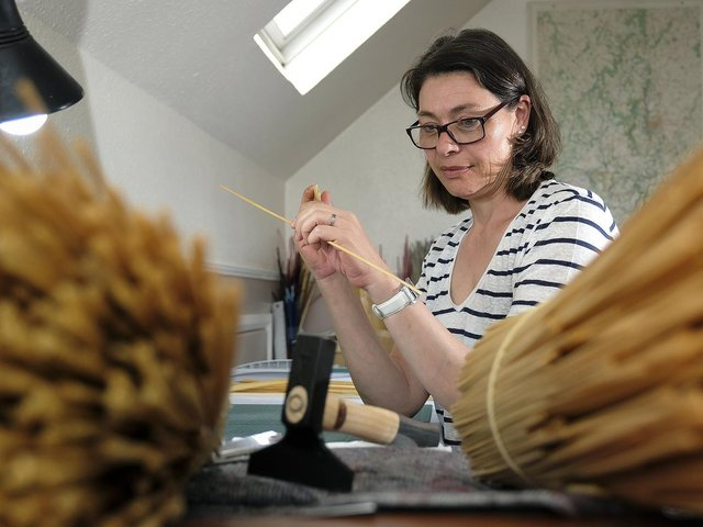 Delphine Robins doing some straw marquetry at her home in Scarborough