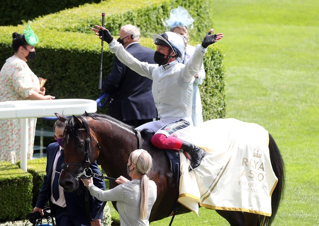 Jockey Frankie Dettori celebrates winning the Queen Anne Stakes on Palace Pier during day one of Royal Ascot.