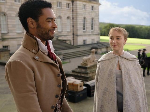 Bridgerton's Phoebe Dynevor and Regé-Jean Page in a scene filmed at Castle Howard. (Credit: Netflix)