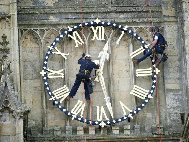 Beverley Minster has it's clock hands returned to the clock face after restoration work by expert workers Stuart Morrison and Stephen Davies. Photo credit: Richard Ponter/JPIMedia