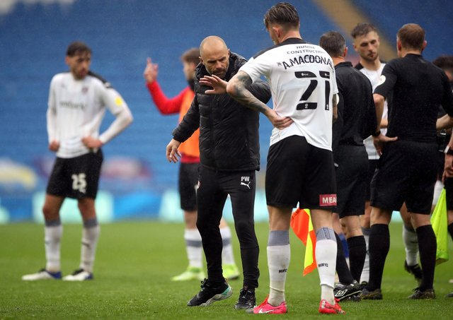 Cost of the drop: Rotherham United manager Paul Warne and Angus MacDonald after their relegation is confirmed at the Cardiff City Stadium. Picture: PA