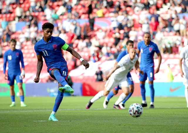 England's Marcus Rashford scores their side's first goal of the game from the penalty spot during the international friendly match against Romania.