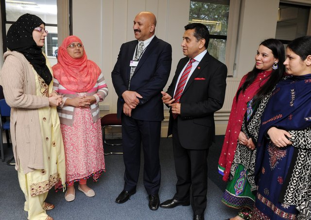 Dr Mohammed Ali OBE (centre), who is chief executive of the Bradford-based QED Foundation, at one of the organisation's events/