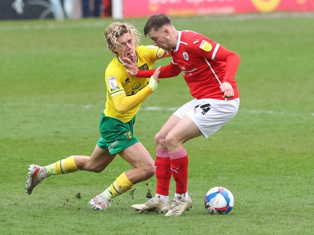 DEBUT: Jasper Moon holds off Norwich City's Todd Cantwell on his first Championship start, in May