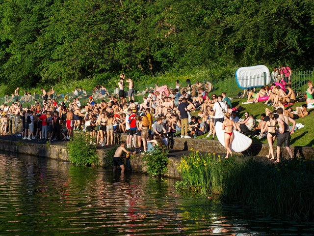 People gather at Crookes Valley Park in the sunshine