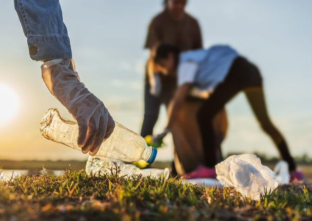 Litter pickers collect discarded plastic bottles and cans - should a recycling scheme be introduced?