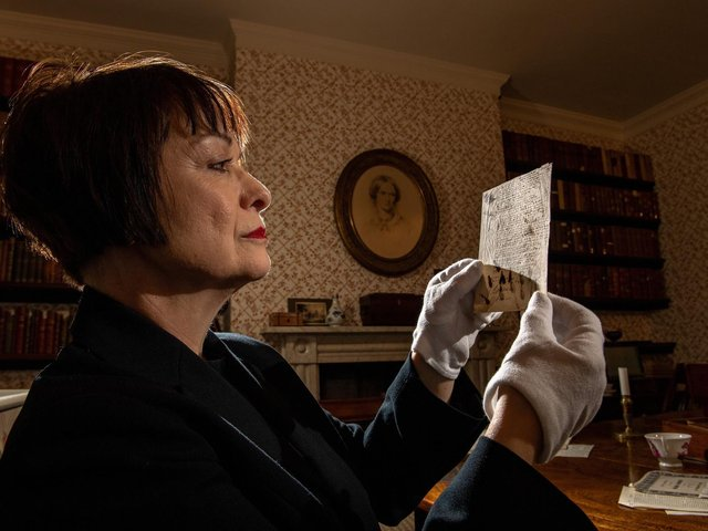 Ann Dinsdale, the Parsonage museum's principal curator, looking through poem manuscripts of Emily Bronte in the dining room..  Picture Bruce Rollinson