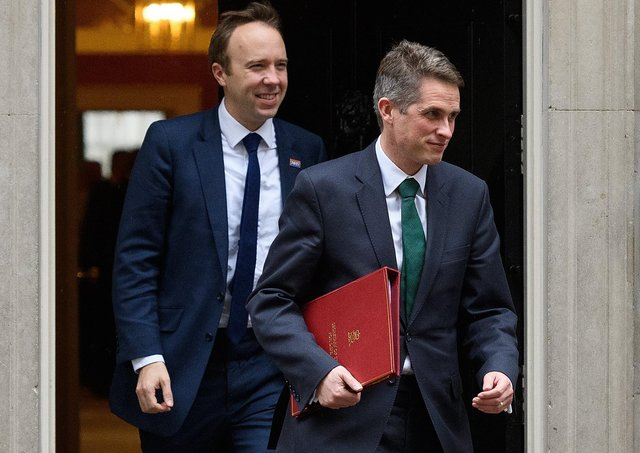 Matt Hancock follows Gavin Williamson out of a past Cabinet meeting.