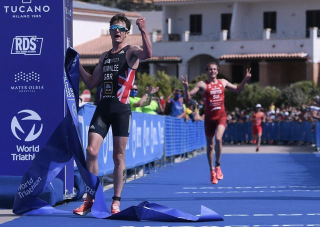 TOP DOG: Jonny Brownlee celebrates as he crosses the finish line at the World Triathlon Cup in Arzachena Emanuele Perrone/Getty Images)