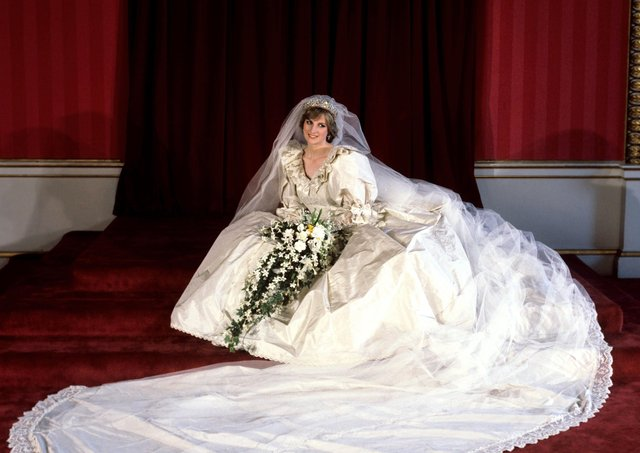Diana, Princess of Wales in her bridal gown at Buckingham Palace after her marriage to Prince Charles at St Paul's Cathedral. The wedding dress is on show at Kensington Palace for the first time in 25 years.  PA/PA Wire