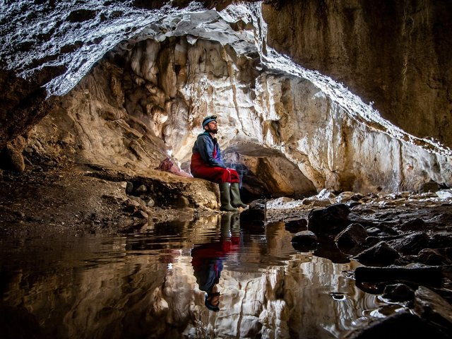 Richard Goodey, from Lost Earth Adventures, admiring the amazing internal cave structure of the Valley Entrance which leads to the Kingsdale Master Cave near Ingleton in the heart of the Yorkshire Dales. Picture: James Hardisty.