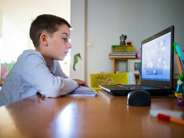 Child at home having remote school on laptop computer. Picture: Adobe Stock