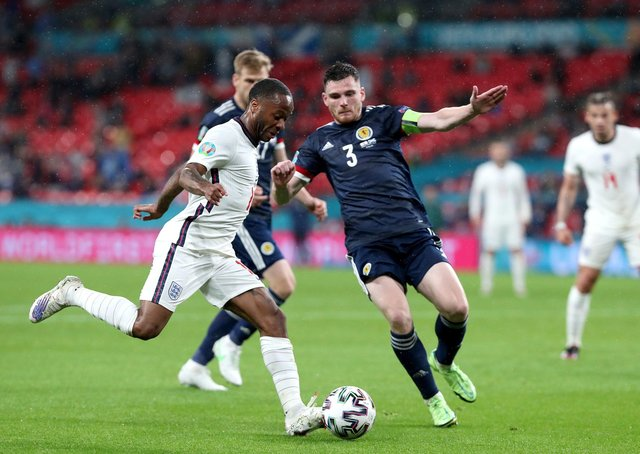 England's Raheem Sterling (left) and Scotland's Andrew Robertson battle for the ball at Wembley Stadium on Friday night. Picture: Nick Potts/PA