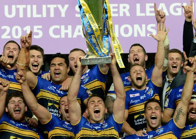 Treble-winner: Leeds Rhinos captain Kevin Sinfield lifts the trophy after winning the Super League Grand Final at Old Trafford in 2015. Picture: PA