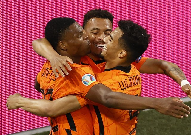 Back in business: Netherlands' Denzel Dumfries, left, celebrates with his teammates after scoring against Austria. Picture: AP