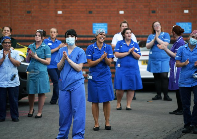 A Clap for Carers celebration outside Leeds General Infirmary during the Covid lockdown.