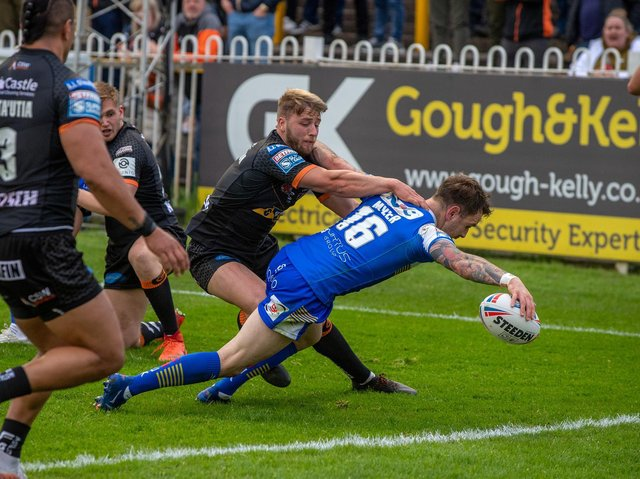 Richie Myler scores for Rhinos in their win at Castleford on May 28, the last game they played before a coronavirus outbreak led to training being cancelled. Picture by Bruce Rollinson.