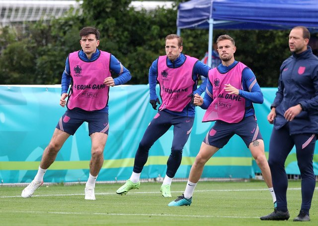 GETTING THERE: England's Harry Maguire (left), Harry Kane (centre) and Jordan Henderson during a training session at Hotspur Way Training Ground. Picture: Nick Potts/PA